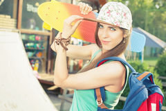 Fashion skateboarder young woman with a skateboard Stock Photos