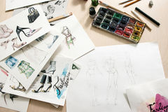 Fashion sketches on designer desk Royalty Free Stock Image