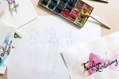 Fashion sketches on designer workplace royalty free stock photo