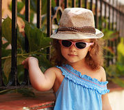 Fashion small kid in glasses and hat posing Royalty Free Stock Image