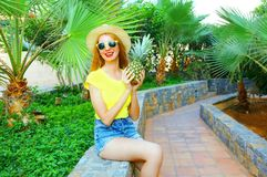 Fashion smiling woman with a pineapple on a palm trees Royalty Free Stock Photography