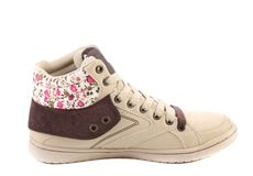 Fashion sneaker with flower closeup. Stock Image