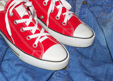 fashion sneakers and jeans Stock Photos