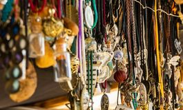 Fashion stand with costume jewellery and simple pendants and chains made of leather and silver royalty free stock photo