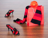 Fashion still life. Photo of the fashion still life with shoes and packet with flower Stock Images