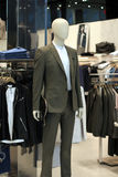Fashion Store Display. Men`s mannequin dressed in suit and tie Stock Photos
