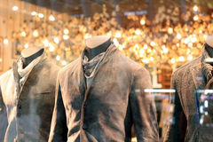 Fashion Store Display. Men`s mannequins dressed in stylish coats Stock Photo