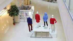 Fashion store interior and mannequins. Boutique display window with mannequins. stock video