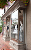 Fashion Store on Main Street. Five mannequins in the window of a store selling women`s clothing Royalty Free Stock Image