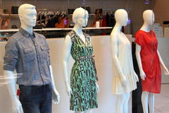 Fashion store window display. Mannequins in a clothes fashion store window display Stock Image
