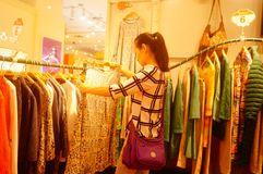 Fashion stores, women are looking for the latest fashions. In Shenzhen, china Stock Image
