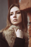 Fashion street portrait of a beautiful woman in fur coat. Outdoor glamour photoshoot Stock Photo
