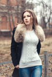 Fashion street portrait of a beautiful woman in fur coat. Outdoor glamour photoshoot Stock Images