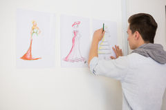 Fashion student drawing pictures on paper Royalty Free Stock Photography