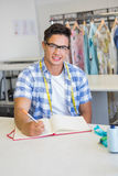 Fashion student with glasses taking notes Stock Photo
