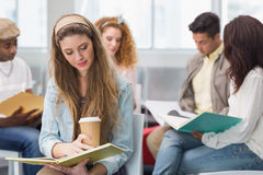 Fashion student reading her notes Stock Photos