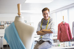 Fashion student sitting with arms crossed Stock Photos