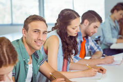 Fashion student smiling at camera in class Stock Photo