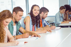 Fashion student smiling at camera in class Royalty Free Stock Photo