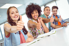 Fashion student smiling at camera with thumbs up Royalty Free Stock Photos