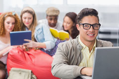Fashion student using his laptop. At the college Royalty Free Stock Images