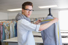 Fashion student working on mannequin Stock Photo