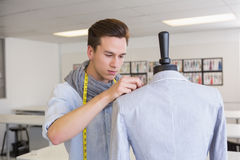 Fashion student working on mannequin Royalty Free Stock Image
