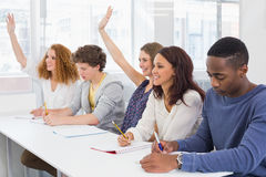 Fashion students being attentive in class Stock Image