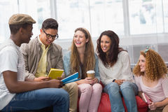 Fashion students chatting and smiling Royalty Free Stock Images