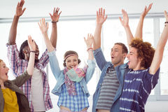 Fashion students cheering together. At the college Royalty Free Stock Image