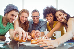 Fashion students eating doughnuts Stock Photography