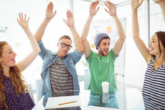 Fashion students with hands up Royalty Free Stock Photo