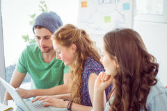 Fashion students looking at computer Royalty Free Stock Photo