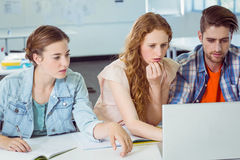 Fashion students looking at laptop Stock Photography