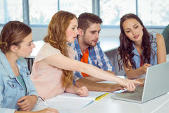 Fashion students looking at laptop Royalty Free Stock Photography