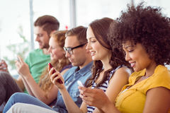 Fashion students looking at their smatphone Royalty Free Stock Image