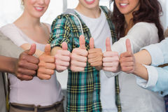 Fashion students showing thumbs up. At the college Royalty Free Stock Images