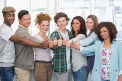 Fashion students showing thumbs up. At the college Royalty Free Stock Photo