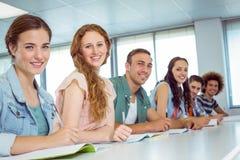 Fashion students smiling at camera Stock Image