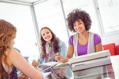 Fashion students smiling at camera Stock Photos