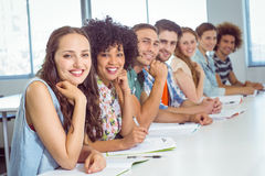 Fashion students smiling at camera Stock Image