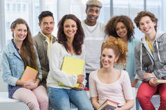 Fashion students smiling at camera together Stock Image