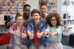 Fashion students smiling at camera together Stock Photos