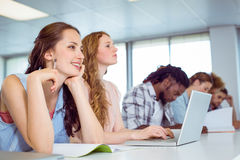 Fashion students taking notes in class Royalty Free Stock Photos