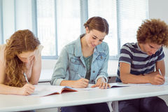 Fashion students taking notes in class Stock Photo