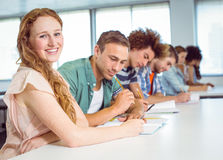 Fashion students taking notes in class Royalty Free Stock Image
