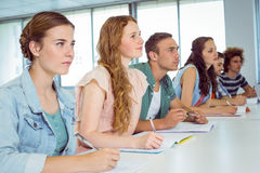 Fashion students taking notes in class Stock Images