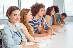 Fashion students taking notes in class Royalty Free Stock Photo