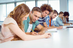 Fashion students taking notes in class Stock Image