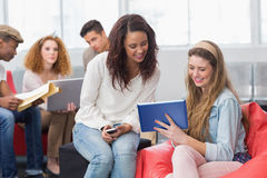 Fashion students using tablet together Royalty Free Stock Photo